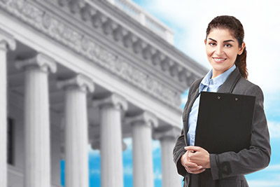 Woman with clipboard on courthouse background