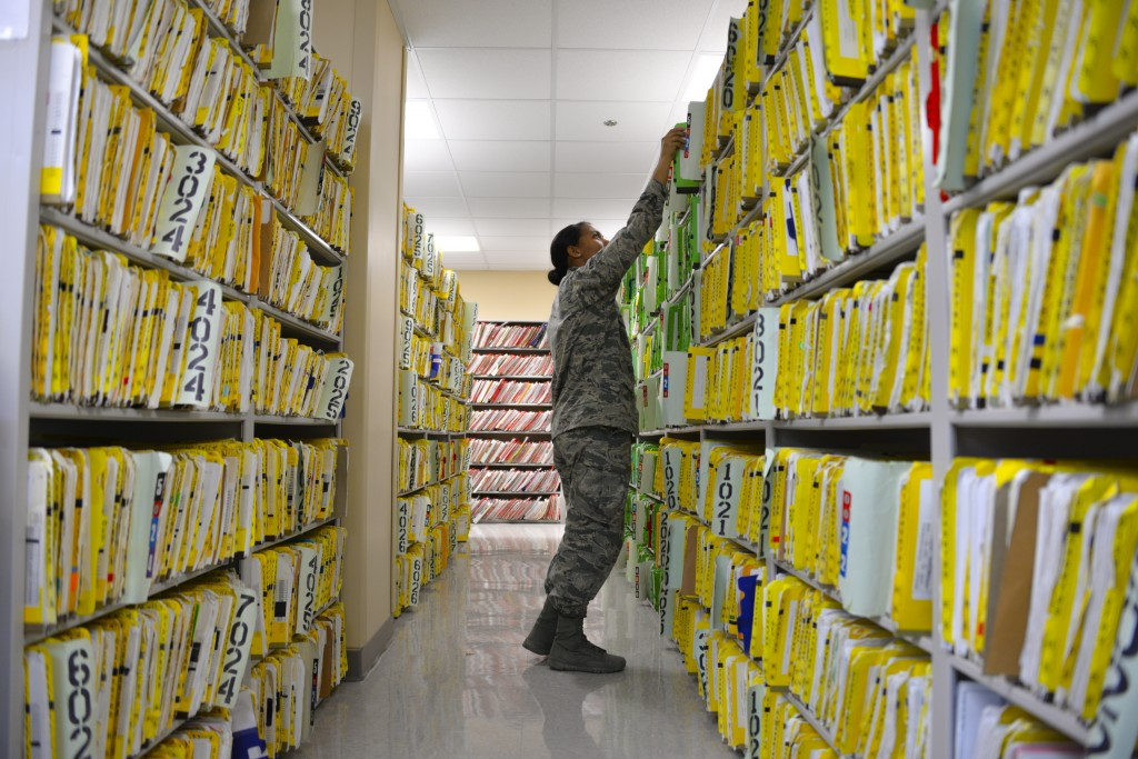 A US Airman files paper medical records. (Photo by US Air Force)