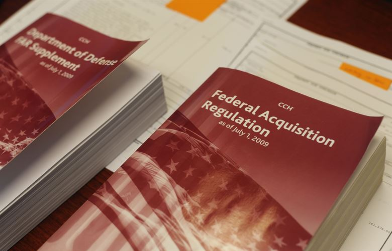 A Federal Acquisition Regulation (FAR) book rests on a contract specialists' desk at MacDill Air Force Base, Fla., Feb. 23, 2017. (photo via USAF)