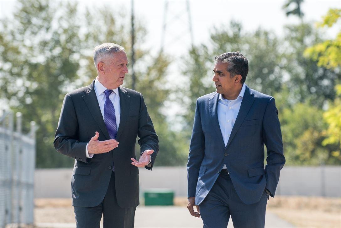 Defense Secretary Jim Mattis speaks with Raj Shah, who headed DIUx until last month. (2017 photo via DOD)